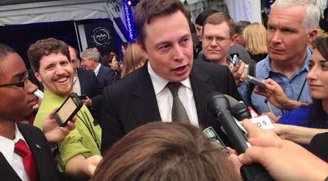 Elon Musk engaging with the media.